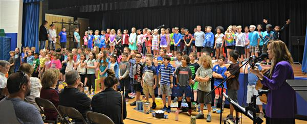 Second-graders perform their songs with KJ