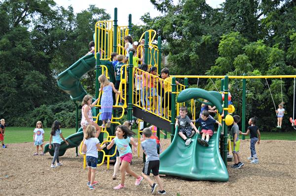 Students enjoy the new playground equipment at Glen Acres