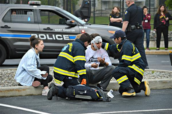 Emergency personnel treat student actors during Henderson's Mock Crash