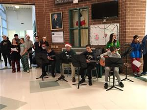 Dr. C playing holiday songs with students