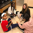 Students work together to make dog toys