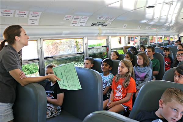 Students talk about safe bus behavior.
