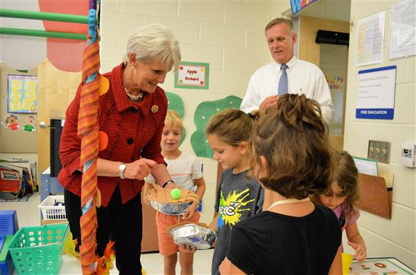 "Representative Carolyn Comitta receives an ""apple pie"" prepared by kindergarten students as part of their dramatic play"