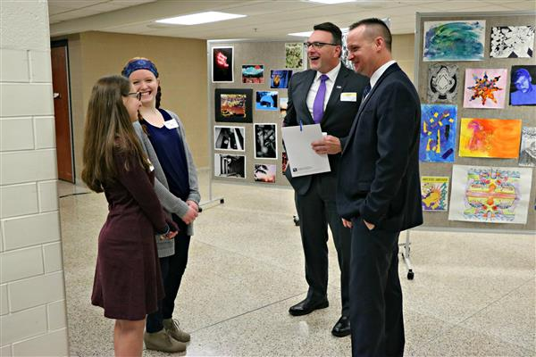 Henderson students speak to area business leaders.