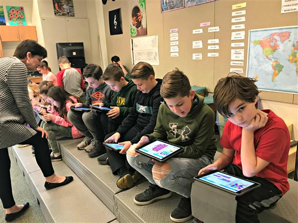 Students at Penn Wood Elementary School use coding to make a character dance to the music.