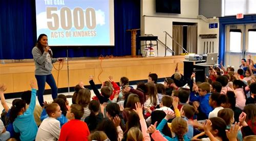 Kelley Perotti from Think Kindness explains the Kindness Challenge to students at Westtown-Thornbury Elementary School
